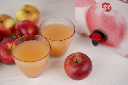 Apple juice  in glasses. Homemade apple juice from box. Stock Photo