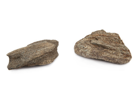 Stones isolated on white background. Two  stones  eroded of water. Top view.