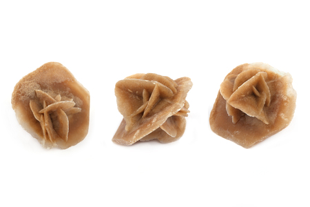 Desert rose isolated on white background. Crystal in three position.