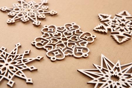 Laser cut wood snowflakes ornaments.  Wooden snowflakes on carton. Stock Photo