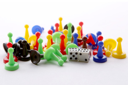 Colorful play figures and dices with double six. Board game pieces and dices.