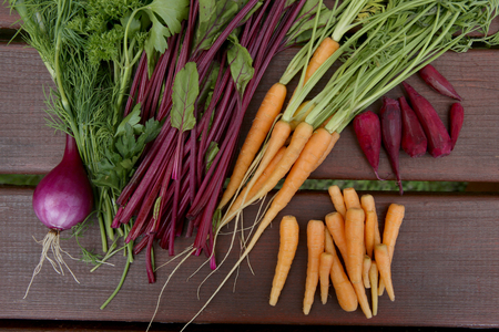 raw: Vegetables: carrots, beetroot, parsley, onion. Fresh raw vegetable soup ingredients.