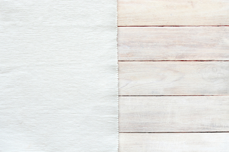 White velvet material and grunge wood board texture background. Surface of aged white wooden planks and striped texture fabric top view. Archivio Fotografico