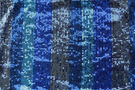 추상 파란색 spangles 배경입니다. 패브릭 질감 밝은 파란색 동그라미 구슬 또는 장식 조각.