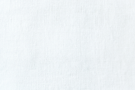 White linen fabric texture. White canvas background. Abstract woven surface.