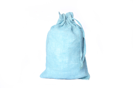 Blue jute  sack for present  isolated on white background.  Woven linen fabric packing bag.