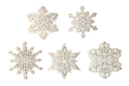Silver snowflakes ornaments isolated on white background. Set of five different silver snowflakes.
