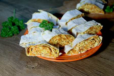 Lavash roll with carrots and cheese. Vegan lavash with fried carrots and onions, soy cheese and soy mayonnaise. Stock Photo