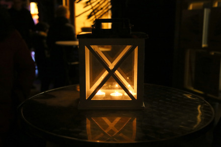Wooden candle. Burning latern in dark. Stock Photo