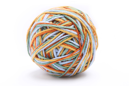 Colorful big thread ball from four color thread. Cotton thread ball isolated on white background. Different color (orange, yellow, green, blue) thread mix. Stok Fotoğraf
