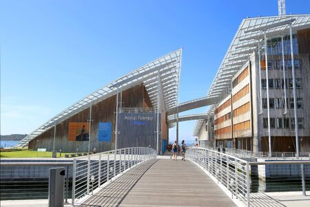 Oslo, Norway - July 24, 2018: Astrup Fearnley Museum of Modern Art. Astrup Fearnley Museum is a contemporary art gallery connects canals in the waterfront of Oslo in Aker Brygge district. Museum designed by Renzo Piano. It consists of two buildings.