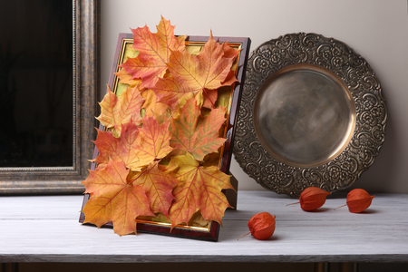 Autumn decoration in interior. Chinese lantern on wooden shelf.