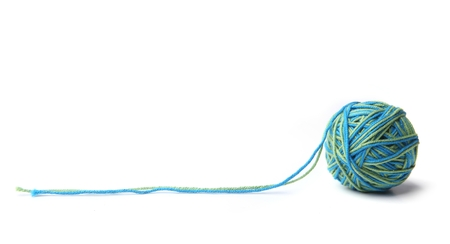 Colorful cotton thread ball from two color green and blue thread  isolated on white background.  Different color green and blue thread mix. Banco de Imagens
