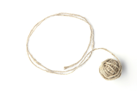 Linen grey string ball with frame made of string isolated on white background. Linen rope ball with empty frame.