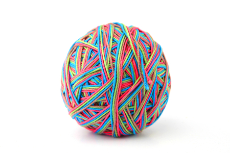 Colorful cotton thread ball from four color thread isolated on white background. Different color pink, green, grey, blue thread mix. Standard-Bild