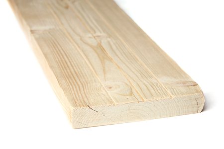 Larch wood plank board isolated on white background. Wood plank close up view. 免版税图像