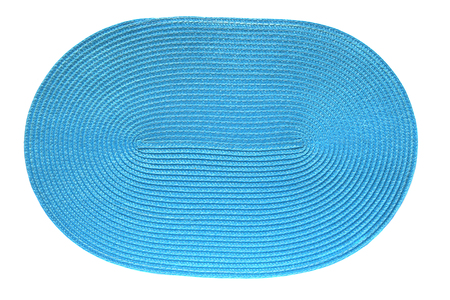 Blue woven napkin isolated on white background. Oval mat for placing plates.