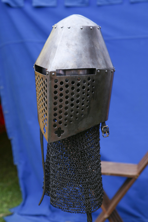 Medieval knight helmet. Iron helmet in the medieval knight tournament.