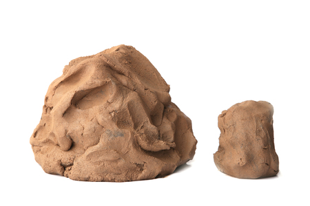 Natural clay piece isolated on white background. Wet clay material for sculpting or modeling. Stockfoto