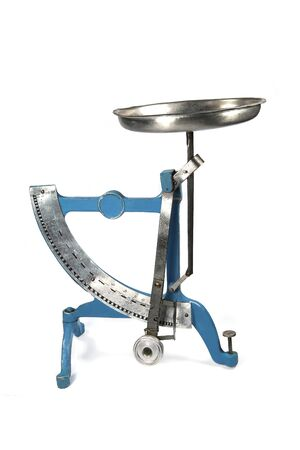 Vintage postal pendulum scales for weighing letters isolated on white background.