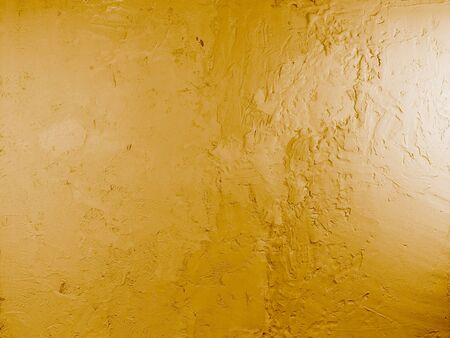 Yellow plaster pattern background. Abstract grunge stucco texture.