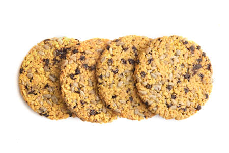 Corn flake cookies  isolated on white background. Cornflake cookies with sunflower seeds, chocolate and condensed milk. 版權商用圖片