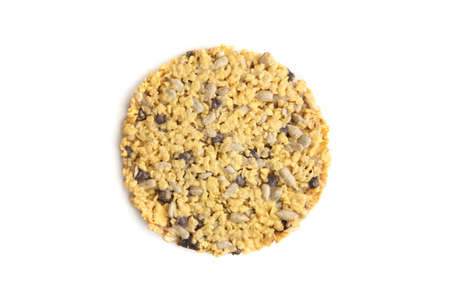 Corn flake cookie  isolated on white background. Cornflake cookie with sunflower seeds, chocolate and condensed milk, top view.