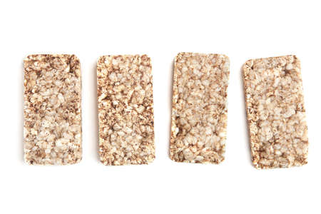 Puffed buckwheat cakes isolated on white background. Wholegrain crispbreads, cereal dietary crackers.