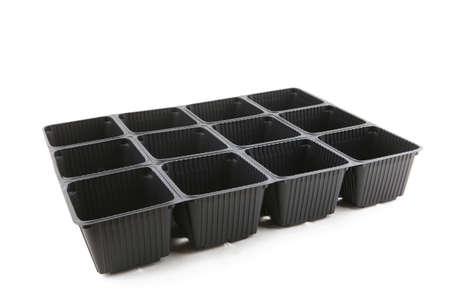 Empty plastic seedling tray isolated on white background. Plastic square plant pots for gardening. 版權商用圖片