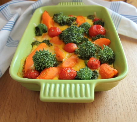 casserole with broccoli,cherry tomatoes and carrots photo