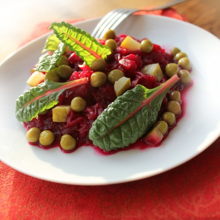 salad with beets, peas, cucumber Фото со стока