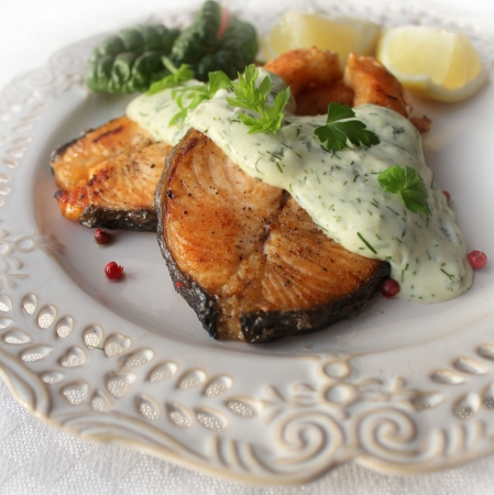 Roasted salmon with sauce photo