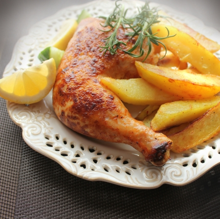roast chicken: roasted chicken leg with fries potato and lemon