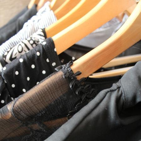 clothes hanging on wooden hangers Foto de archivo