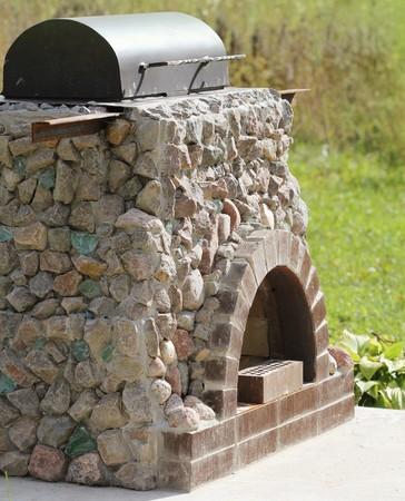 Outdoor fireplace from stone Фото со стока - 45957635