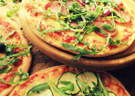 smack: Pizza with sausage, cheese, ruccola, zucchini Stock Photo