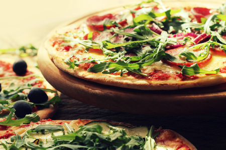 ruccola: Pizza with sausage, cheese, ruccola Stock Photo