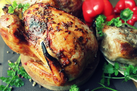 meatloaf: Grilled whole chicken with fresh herbs,fillet, meatloaf on table