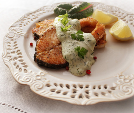 Grilled salmon steak with sauce Stock Photo