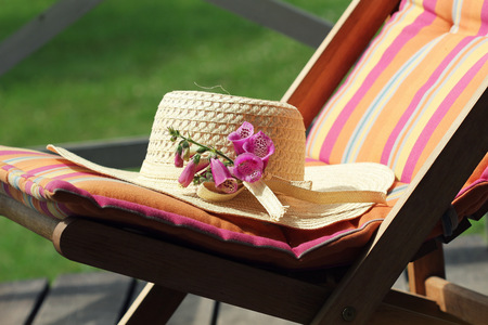 wooden chair with women hat Stock Photo