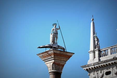 Saint Theodor statue on a column on the Piazza San Marco of Venice in Italy - Colonne di San Teodoro