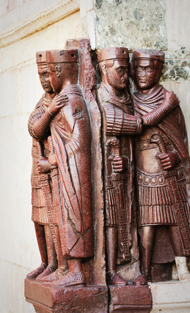 Statues of Diokletian and three other emperors in Venice on San Marco square, Italy.The Tetrarchs is 4th century porphyry sculpture representing Diocletian, Maximian, Valerian and Constance Stock Photo