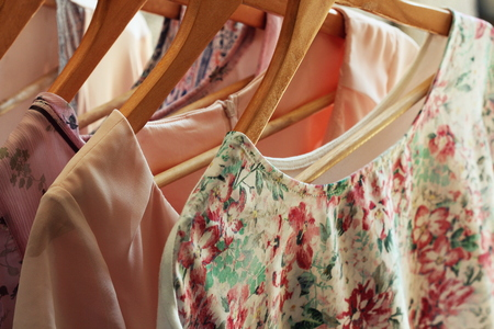 collection of womens clothes hanging on rack Stock Photo