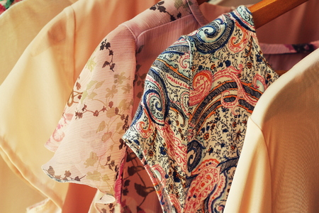 collection of womens clothes hanging on rack for sale Stock Photo