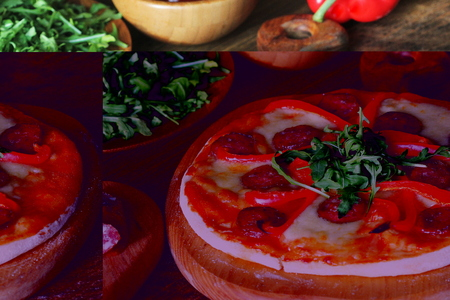 Hot homemade pizza with Pepperoni, paprica, rucola on wooden cutting board