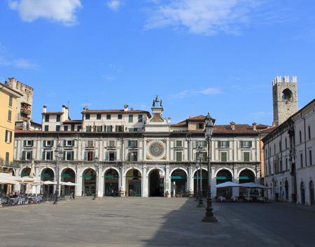 The clock tower on the Piazza della Logia in Brescia. Italy .