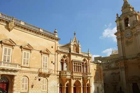 House facade at St. Paulss Square and St. Pauls Cathedral in Mdina, Malta