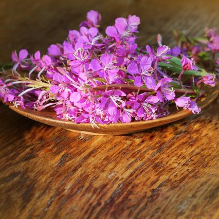 Flower Willowherb - Epilobium Angustifolium on wooden background .