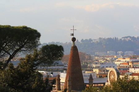 Cityscape of Rome, Italy, a view with tower clock of Basilica of Santa Maria del Popolo