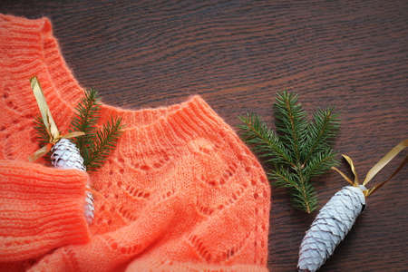 Online Christmas shopping and sale concept. Flat lay of woman knited sweater with christmas decor .